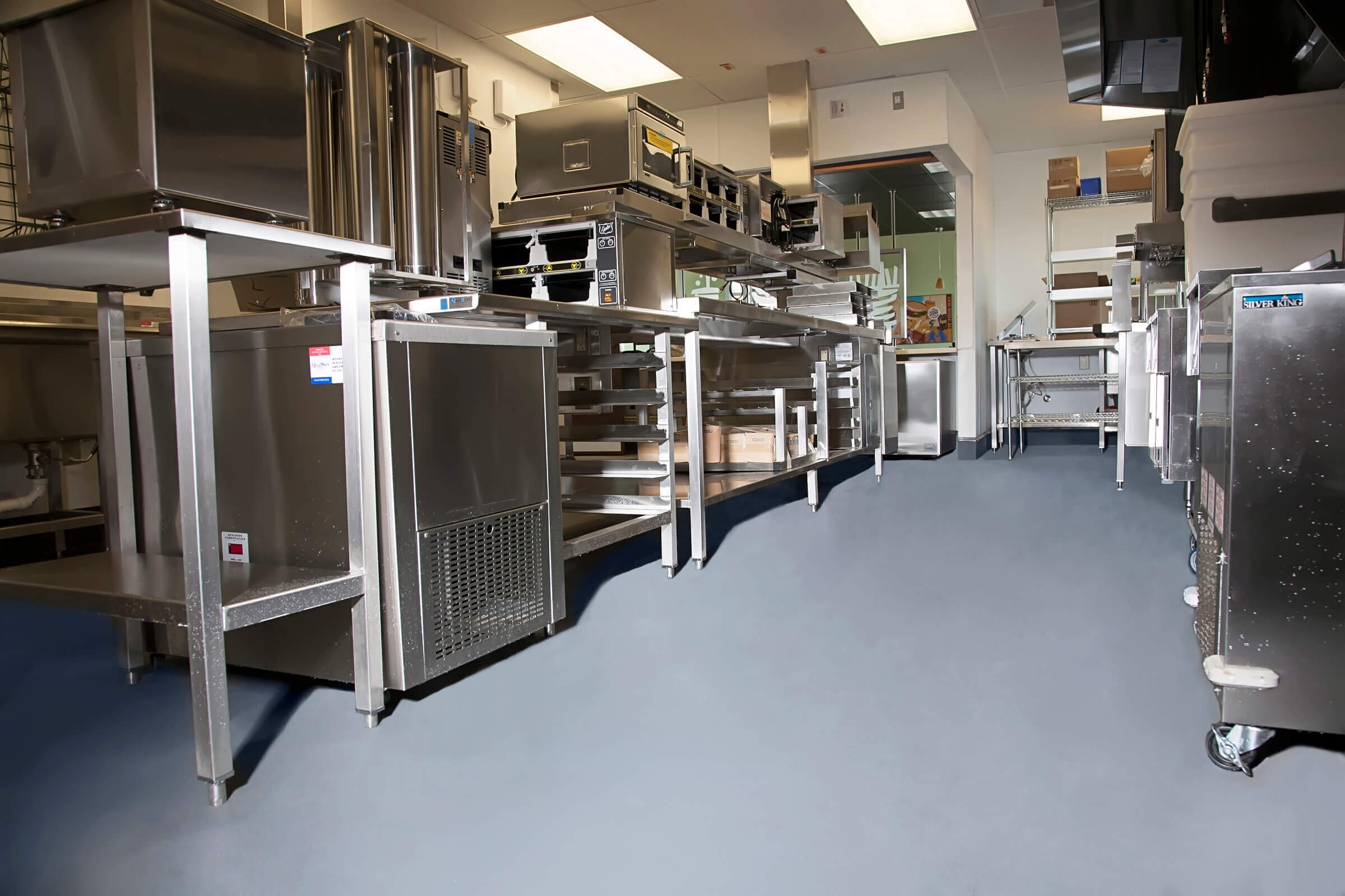 commercial kitchen flooring epoxy & stained concrete| industrial